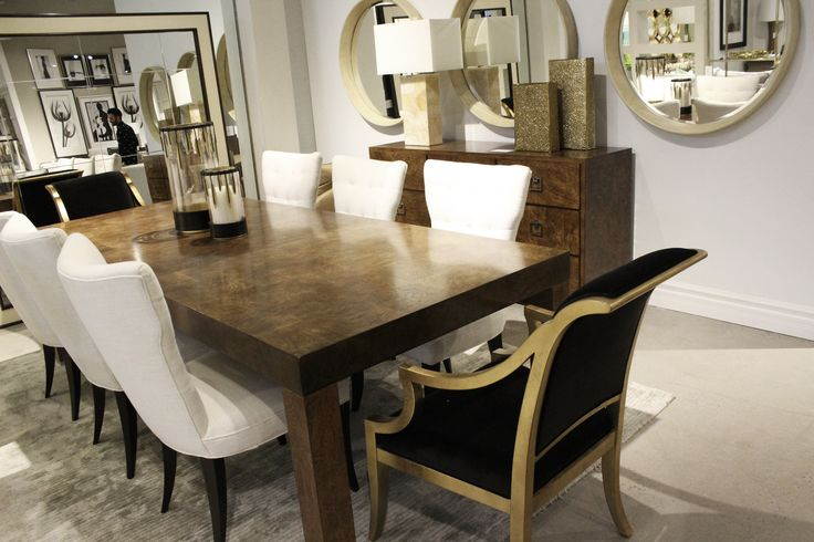 http://www.avenuedesigncanada.com/ItemBrowser.aspx?action=attributes&ItemType=Furniture&event=reset&wcsearch=SOHO%20LUXE Burlwood table with gold foil chairs and floor to ceiling mirror at Avenue Design.