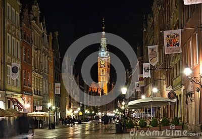 Illuminated old city center with a colored tower in the evening, main square in Gdansk - Danzig city, Poland