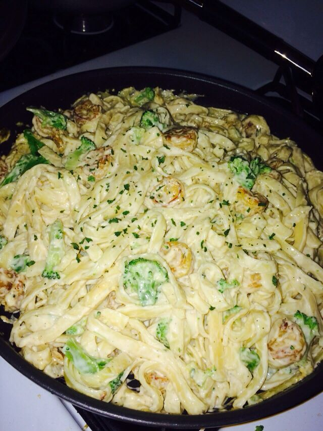 This is Shrimp Alfredo with broccoli that I made! Something yummy and easy to make! Took about an hour and half to complete it all. I used Ragu Alfredo sauce, medium sized shrimp, broccoli, fettuccine pasta and grated Parmesan cheese!!