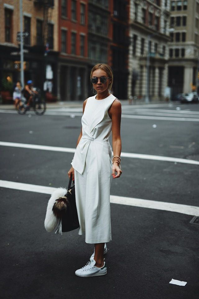 Work culottes into an all white outfit by matching them with a tie-front shirt and sneakers. Via Nina SuessShops: Not Specified