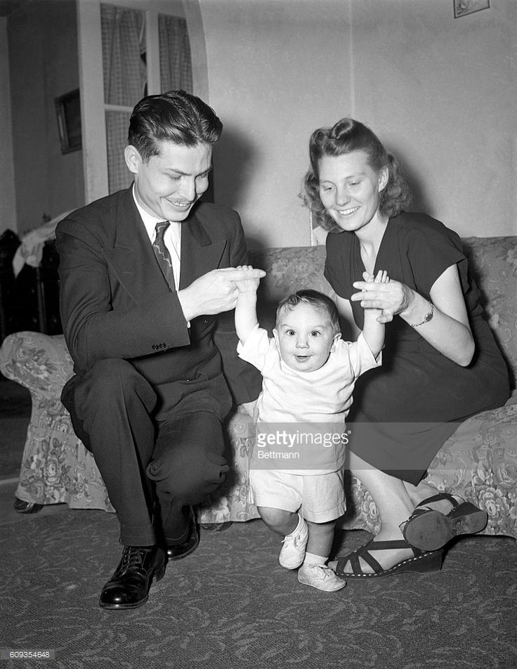 Desmond T. Doss was the first conscientious objector to be awarded the Congressional Medal of Honor. He is shown in the photo with his wife Dorothy and his son Desmond, Jr. at his Richmond, Virginia home (1948).