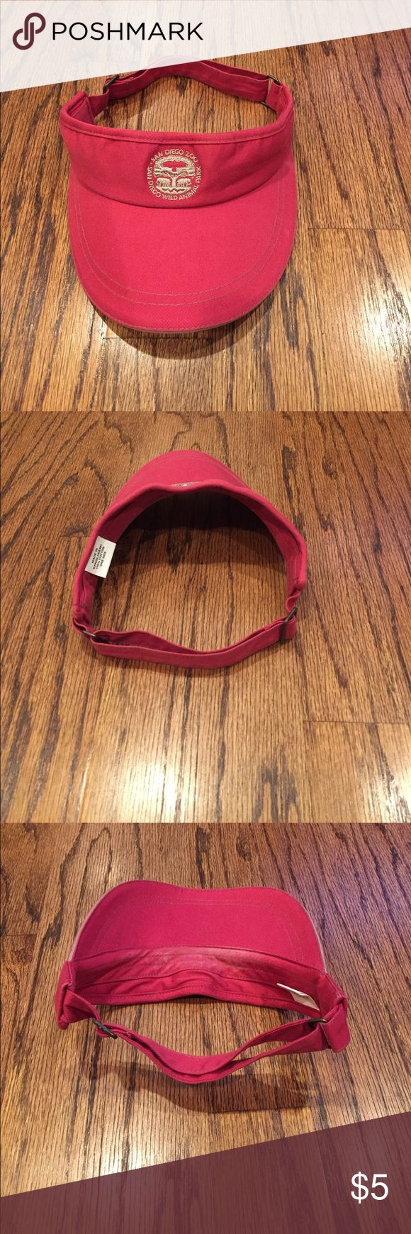 Red San Diego Zoo and Safari Park Visor There is a mild sunscreen stain (see pictures) but it is otherwise in great shape. Accessories Hats