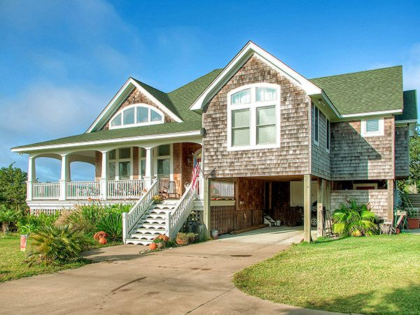Mermaid cafe 39 4 bedroom canal front home in frisco obx for Canal front house plans