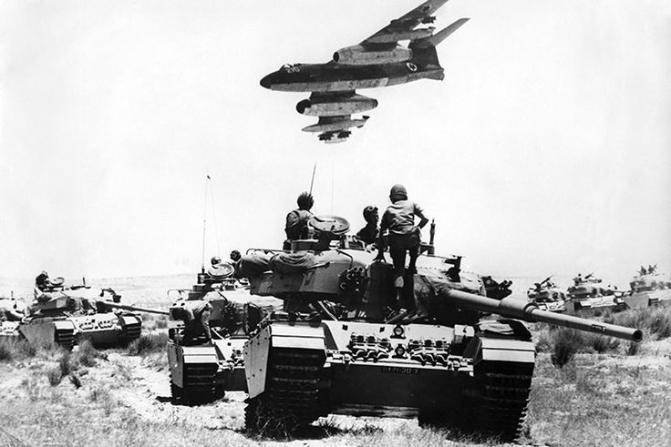 The Iron Curtain Torn By Israel.  An Israeli Vautour  bomber flies over tanks assembling in the Negev desert on May 24th,  1967, two weeks before the outbreak of the  Six Day War.  © Topfoto