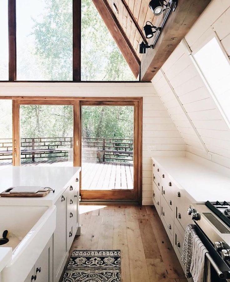 white kitchen with wood floors. mountain house.