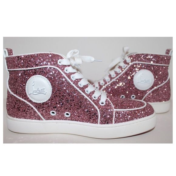 Christian Louboutin Pink Glitter Sneakers RARE & SOLD OUT! - Authentic Christian Louboutin Pink Glitter High Top Sneakers (White Leather Trim), size 39. Purchased at Saks Fifth Avenue. In new condition. Includes its original box/2 dust bags. Signature Louboutin circular nameplate on the side of each shoe. Leather insole w/ the Christian Louboutin name embossed at the heel pad. Red & white rubber soles that feature the Louboutin name. I also own these in gold. AMAZING to say the least! PM…