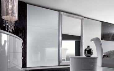 Italian wardrobe with sliding doors from the Privilege range. White glossy lacquered lateral Riquadro doors, silver leaf and mirror.