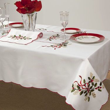 Holiday Cutwork Table Linens - a Lenox design; interesting idea if my embroidery machine works with scans of dish patterns or other items....