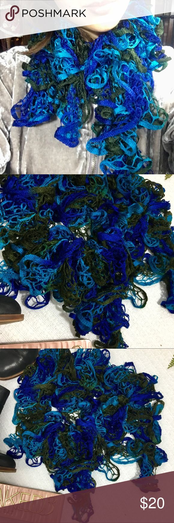 Blue Ruffle Knit Lace Scarf This is such a beautiful fun scarf. Two different tones of blue are mixed in with an olive green. It is a stretchy knit lace material that looks gorgeous and has some bounce. EUC 💕 Accessories Scarves & Wraps
