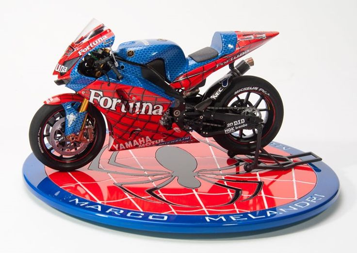 Jeff Wallen, Tucson, Arizona  Jeff dressed Tamiya's 1/12 scale Yamaha YZR-M1 in a colorful Fortuna Spiderman livery worn on a bike raced by Marco Melandri. The parts were painted with Tamiya spray-can red and blue over white primer.