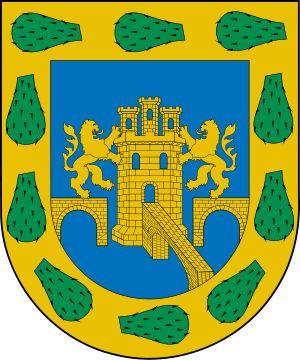 Escudo de Ciudad de México D.F. El actual escudo del Distrito Federal es una estilización del escudo otorgado por el rey español, Carlos I de España, el 4 de julio de 1523. El diseño se basa en proyecciones sombreadas que destacan el puente central, que se representa de frente como una faja que se cierra, mientras los laterales presentan un arco entero y uno cortado que no toca el basamento cuadrado con semiarcos a los costados que sirve de base a una torre con una puerta y sin ventanas.