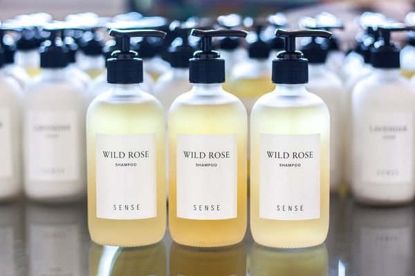 Wild Rose Shampoo using 100% rose essential oil, packaged in a premium frosted glass bottle. Elevating the luxury in your home with a  minimal label.