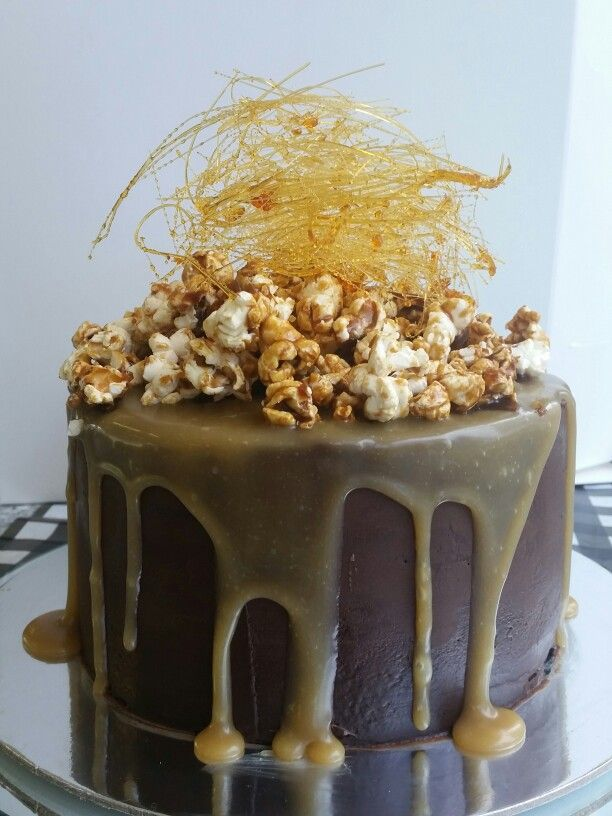 Chocolate mud cake layered with salted caramel buttercream, covered in dark choc ganache, salted caramel drip and topped with salted caramel popcorn and spun toffee.