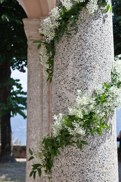something like this for wood table?  Loose ivy and baby's breath garland for wood table?