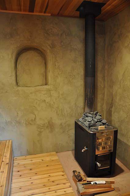 a harvia 20 es stove in a strawbale sauna.