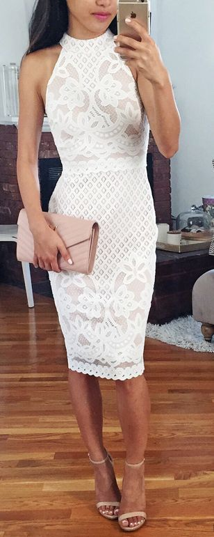 White lace body-con dress with strappy white heels and a blush colored clutch.
