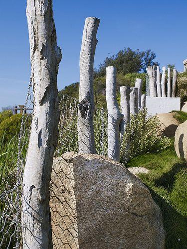 Log fence & boulders