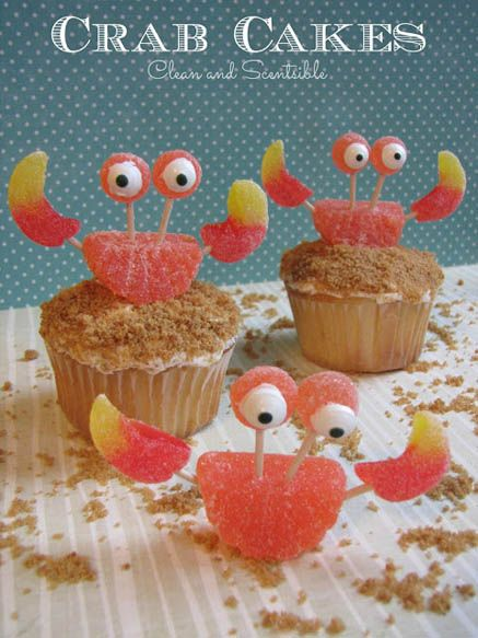 Crab cupcakes! For these cupcakes, roll the frosted tops of the cupcakes in brown sugar so it looks like sand.  Use assorted fruit chews and toothpicks for the body, claws, and eyes.  For the rest of the eyes, add a dot of white frosting, followed by another smaller dot of brown frosting. Voila!