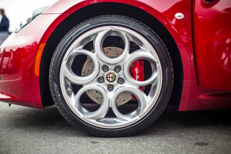 """I'd never noticed before seeing this photo, the way that the 4C's take on the classic Alfa Romeo """"Phone Dial"""" wheels, have that beautiful sweep under the rim at the finish of each spoke.  These are gorgeous rims..."""
