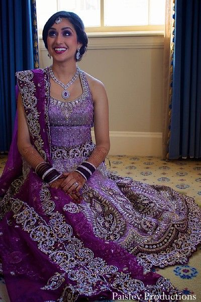 This indian bride poses for portraits as she gets ready for her wedding reception.