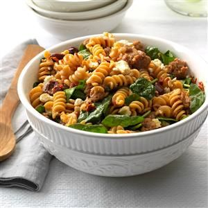 Greek Pasta Toss Recipe -I developed this bright pasta dish with my husband, tossing in our favorite Greek ingredients like olives, feta cheese and sun-dried tomatoes. Try it with shrimp or chicken, too! —Terri Gilson, Calgary, Alberta