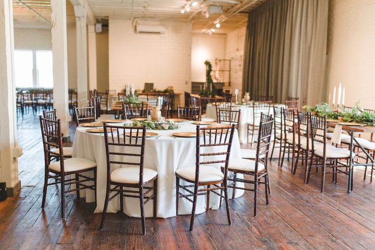 BRIK Venue | Lindsay Davenport Photography | Fort Worth | Wedding | Texas | DFW | Events Venue | Industrial | Warehouse | Reception | Wood Tables | Banquet Tables | Round Table | White Linen | Chiavari Chairs | Greenery | Candles | Gold Chargers | White Plates | Table Decor | Wood Floors | White Brick