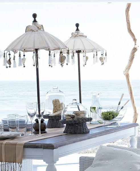 Outdoor dining. Look at the pair of table top umbrellas. Amazing and unique idea. Perfect for any backyard BBQ or summer backyard fun.