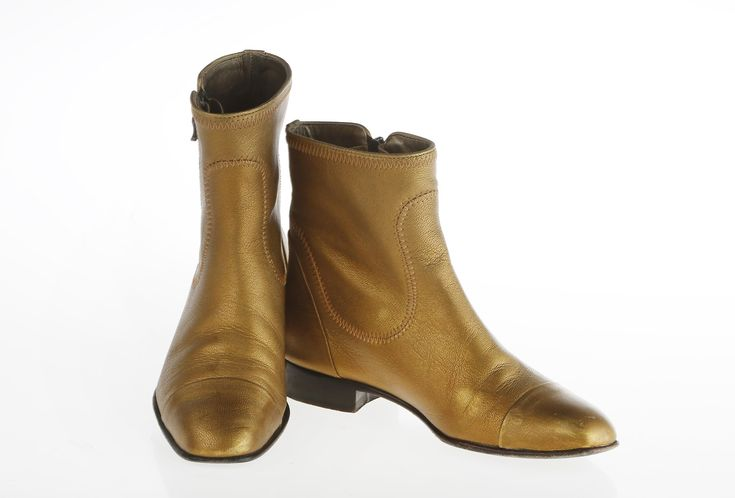 Of course, that's when I saw them. Flat ankle boots. Simple, almost sensible. Except they were a pebbly leather the color of soft, aged gold. They were boots for a veteran female rock star, maybe Patti Smith — agelessly cool. I looked at them as I'd looked at my husband for the first time and thought: I could be with those forever. Until death do us part.  Boots: Lanvin