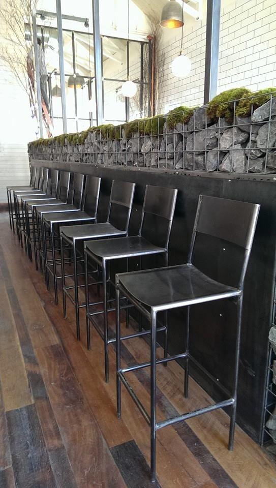 Bar stools steel wall work light post and gabion
