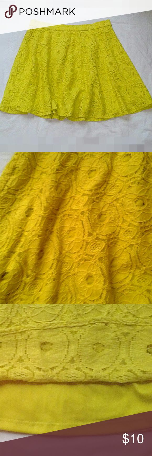 Forever 21 Yellow Lace Swing Skirt Yellow lace over solid yellow lining. The Length is 16 inches. The shell is 87% cotton and 13% nylon. The lining is 100% poly. The zipper is on the back of the skirt. Excellent like new condition. Forever 21 Skirts Circle & Skater