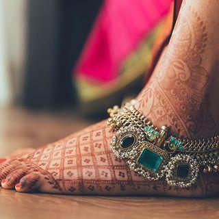 We are totally crushing on Charita's stone-studded payal.  Photo Courtesy- Vinay Venugopal Photography and Roma Ganesh Photography  #payal #bridaljewelry #jewelry #anklet #bridalaccessories #stonstudded #weddingstyle #bridalfashion #instafashion #fashionista #ootd #jewellery #bridaljewellery #anklets #bride #indianbride #bigfatindianwedding #weddingplanning #weddinginspiration #indianwedding #ethnicwear #indianfashion #wedding #mehendi #feet #henna