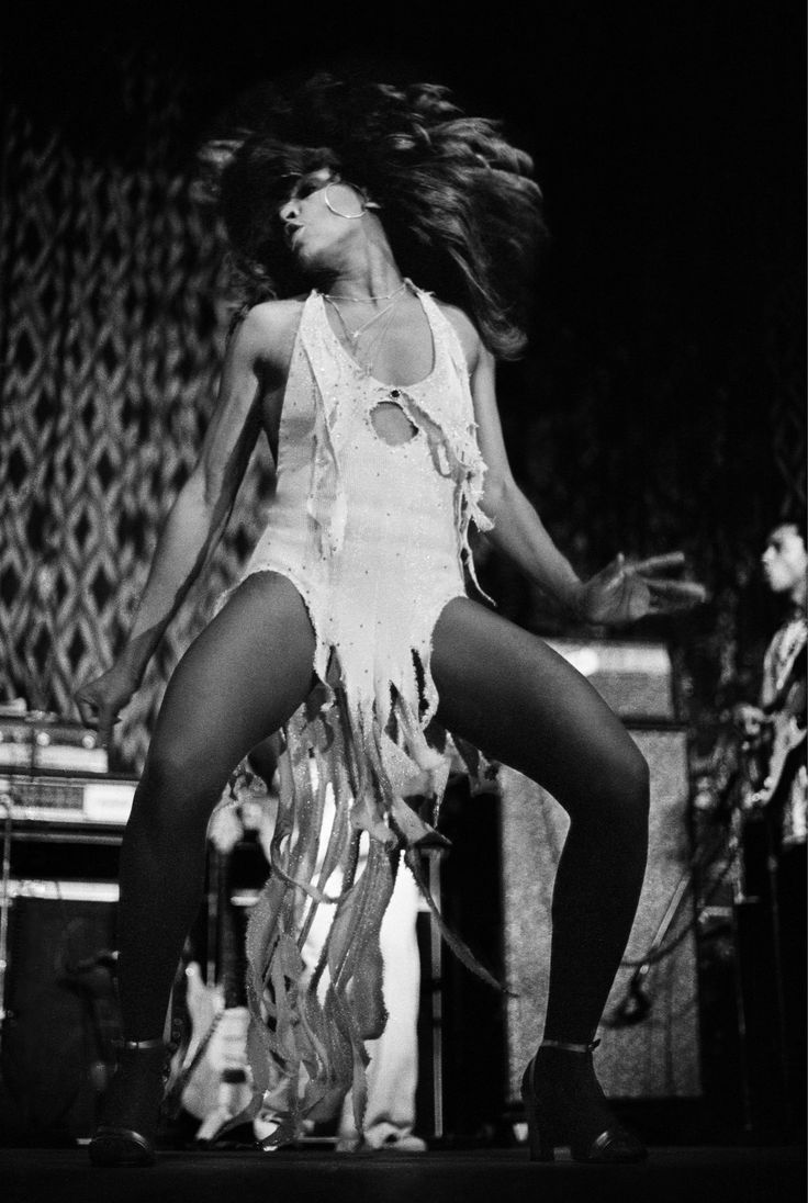 Tina Turner by photographer Lynn Goldsmith.   Love the way she dances, I am in awe of her legs!