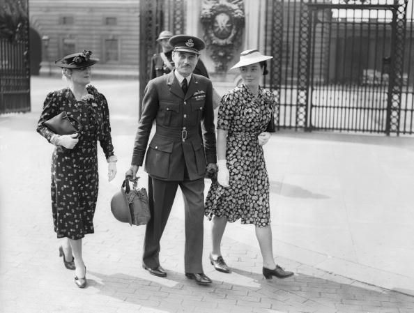 Squadron Leader Louis Arbon Strange, DSO, DFC, MC, leaves Buckingham Palace with his daughter Susan, after receiving a Bar to his DFC, 3rd September 1940. Susan Strange later distinguished herself in the field of political economics. (Photo by Commander Harrison/Fox Photos/Hulton Archive/Getty Images) #london #war #East_End