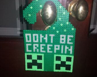 Minecraft character hama bead glow in the dark 'Do not disturb' door sign.