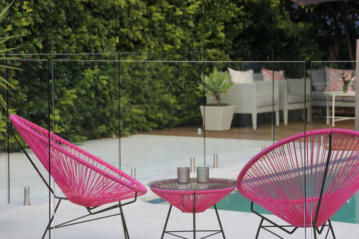 Love these hot pink outdoor chairs by the pool!