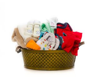 """Assorted Colours"" Baby Basket - Woven Glazed Wicked Basket w/ Handles, One Blanket, Two One-Piece Undershirts, Two Sleepers, One Pair Slippers, Assorted Socks, Assorted Wash Cloths  $65.00 CAD"