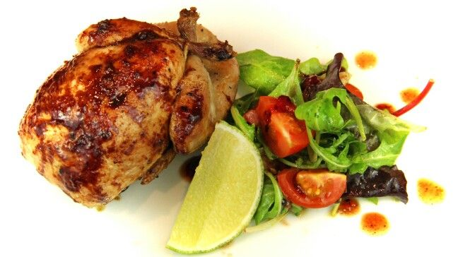 Honey and lime roasted quail with raspberry and balsamic dressing