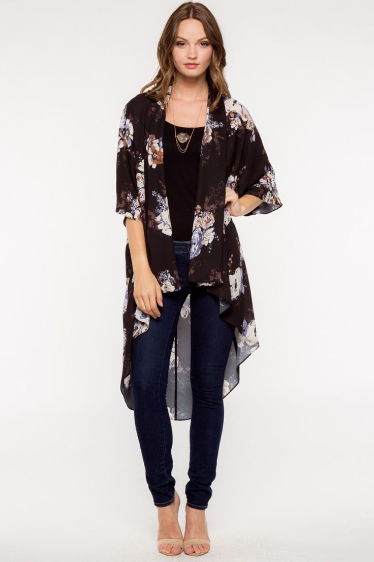 Description: Kimono cardigans are perfect to throw on over just about any outfit, and this one is no exception! Featuring a gorgeous, bold floral print, this long and flowy cardi has such a cool boho