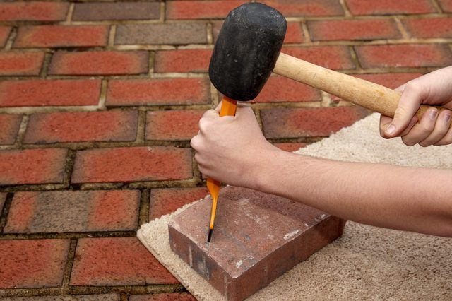 When installing a patio or walkway with paver stones, there will almost always be areas where the pavers must be cut to fit in irregular areas or around objects. Cut paver stones with a chisel for areas that require smaller paver pieces. These areas include cutting paver stones around drain lines that run under a patio, around posts for decks or...