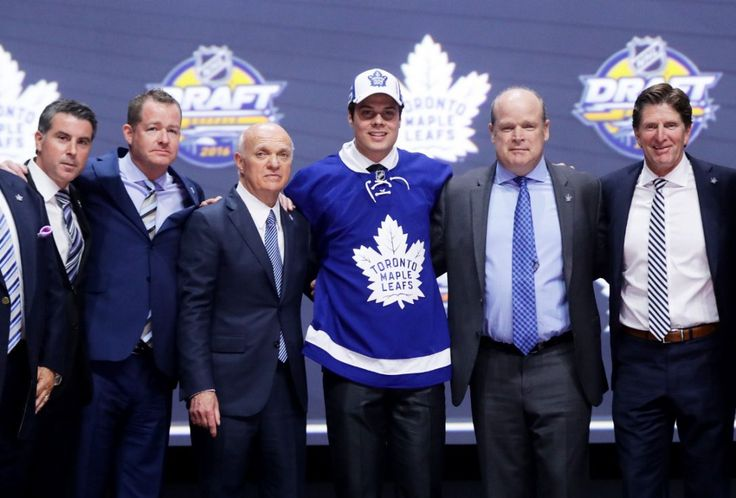 Auston Matthews celebrates onstage with the Toronto Maple Leafs brass after being selected first overall Friday night at the NHL draft. June 24, 2016