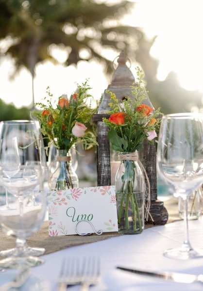 Lanterns and bottles centerpieces by LM Weddings Riviera Maya