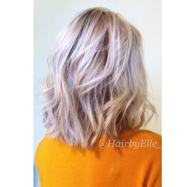 Thick choppy blonde bob platinum highlights and blunt ends