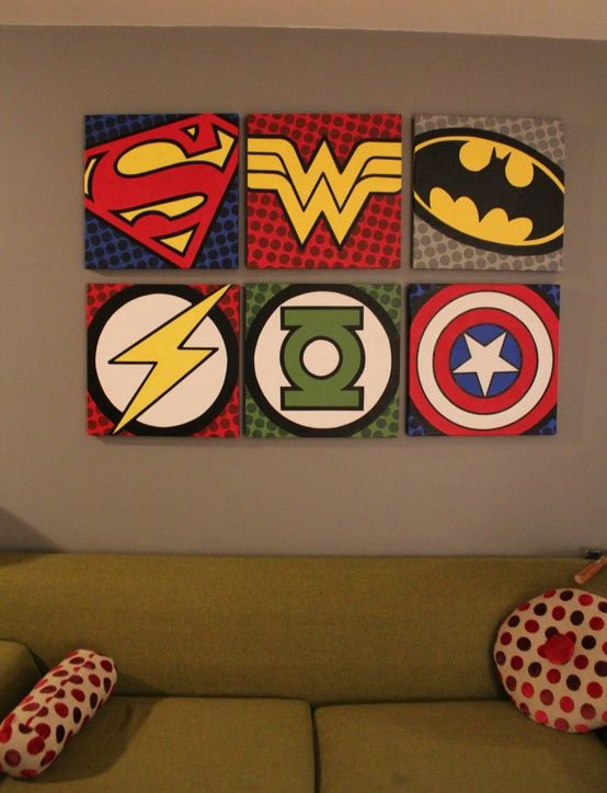 logos on posterboard batman wonder woman superman flash green lantern