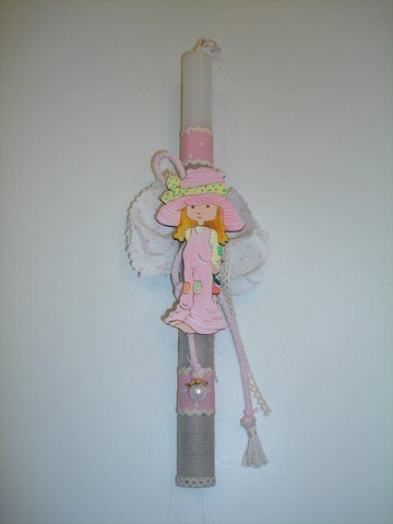 Handmade Easter candle decorated with hand painted wooden Sarah Kay figure.  www.artimiva.gr