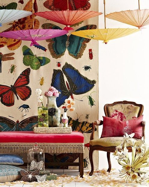 Rug on wall and hanging umbrellas ... bright http://pull.imgfave.netdna-cdn.com/image_cache/1337206843913017.jpg
