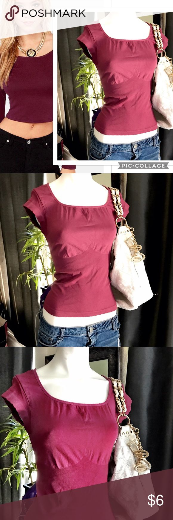 Merona Burgundy Bodycon Top Merona Burgundy Form Fitting Body Con Top. Short sleeve with stretch fitted bodice. Accenture bust line pattern as shown. Size States Medium runs Small. Shown on Size 3/5 Mannequin. Merona Tops Blouses