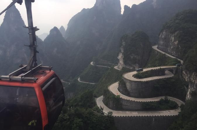 Day Trip in Tianmen Mountain of Zhangjiajie Tianmen Mountain is the highest mountain in Zhangjiajie. With the elevation above sea level at 4,980 feet (1,518 meters), it is praised to be the soul of Zhangjiajie.Your tour guide and driver will pick you up from the lobby of your Zhangjiajie hotel and transfer you to Tianmenshan National Forest Park Cable Car Station. Then, take the cable car uphill to explore Tianmen Mountain.Brief Introduction of Tianmen Mountain:Tianmen Mountai...