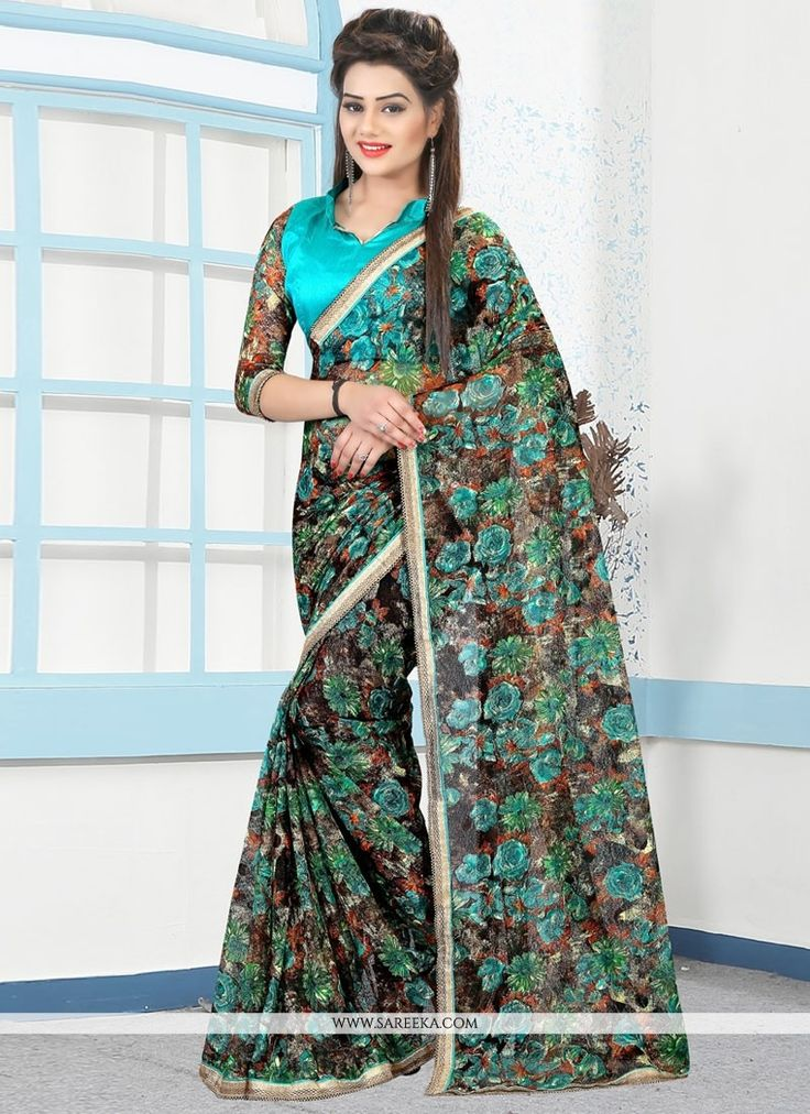 You will be confident to make a strong fashion statement with this black and blue net casual saree. Beautified with lace and print work all synchronized nicely through the pattern and design of the at...