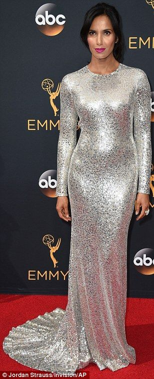 Shining star: Padma Lakshmi was dazzling in her long-sleeved and floor-length silver sequined creation