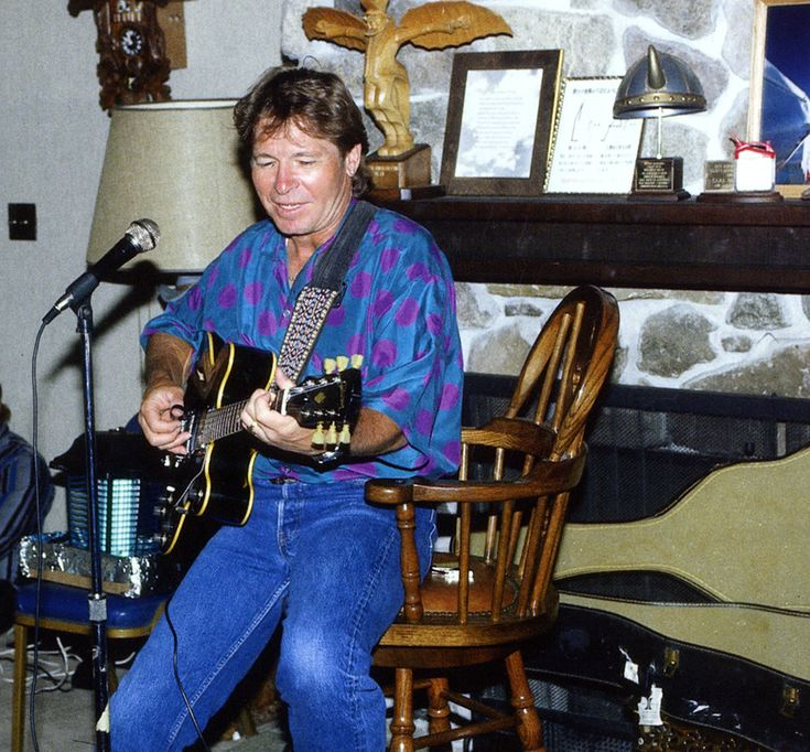 At Barron Hilton's Flying M Ranch. After a day of flying John would graciously serenade Hilton and his guests with his ever-present guitar